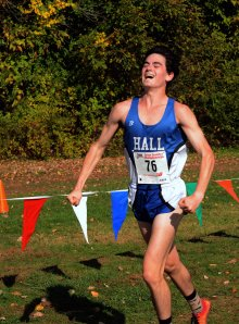 MANCHESTER 10-25-2014 Hall High Ari Klau celebrates as he approaches the finish lane during a CIAC Class boys and girls cross country championships Saturday afternoon at Wickham Park in Manchester Ari won first place (Marc-Yves Regis I, special to the Courant)
